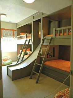 This is a neat idea for a cottage, or kids sleepover room... change out the slide for stairs when kids are older.