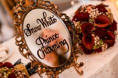Snow White inspired vintage gold mirror reception table decor -- I love that it's on a mirror