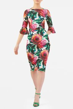 A high boat neckline with a higher back gives our floral print feminine sheath a decidedly retro feel, with a seamed waist setting off a slim skirt.