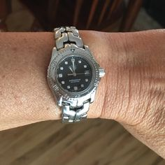 TAGHeuer diamond dial ladies black mini watch Beautiful pre-owned TAGHeuer professional diamond dial mini ladies watch WT-1427. Authentic, original owner, no box but have certificate card. Battery replaced and watch sealed. Tag Heuer Jewelry