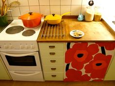 Marimekko curtain---I can see doing this to the dishwasher!