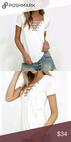 """NEW White Lace-Up Top Super cute lace up or (or down) white top.  Super soft milk silk feel great on your skin.  Not sheer but a dark or bright bra will show through.  Has stretch to it.  Goes great with anything which makes this a closet, """"must have."""" Tops Tees - Short Sleeve"""