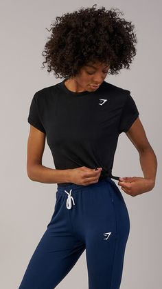 Essentials. The Gymshark Essential Tee offers a loose, comfortable fit, allowing you to move freely through your workout. Featuring a midi crop length with slant hem design, it's your go-to tee with an edge. Coming soon in Black.