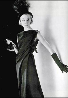 1957 Tissue thin black wool in an interestingly draped tunic by Christian Dior