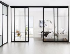Did you know that you can use Elfa sliding doors as room dividers? See our sliding door designs and choose a suitable room divider for your home here. Sliding Door Room Dividers, Partition Door, Hanging Room Dividers, Room Divider Doors, Room Doors, Closet Doors, Glass Partition, Internal Sliding Doors, Sliding Glass Door