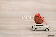 "Download the royalty-free photo ""Miniature Car carrying a Heart on roof. Holiday  love concept with copy space. Valentine's day background "" created by stillforstyle at the lowest price on Fotolia.com. Browse our cheap image bank online to find the perfect stock photo for your marketing projects!"