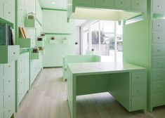 Japanese acupuncture clinic lined with mint-green cabinets.