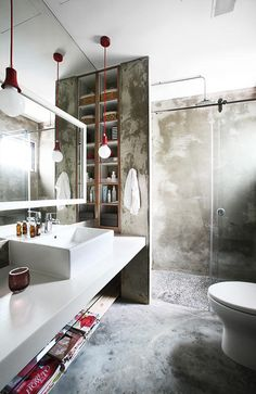 Cement bathroom with pebbled bath area | Home & Decor Singapore - long mirror and sink area
