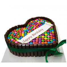This is heart shape kit kat gems chocolate cake which is special for any precious occasion. You can bring this cake by ordering online from our website. We provide instant delivery within 2 to 3 hours in Noida. Chocolate Kit Kat Cake, Heart Shaped Chocolate, Tasty Chocolate Cake, Gem Cake, Online Cake Delivery, Heart Shaped Cakes, Order Cake, Cake Truffles, Hearts