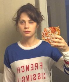 Zooey Deschanel's morning selfie is improved by a slice of cold pizza, the breakfast of champions.