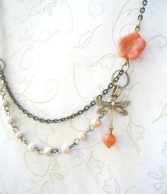 Excited to share this item from my shop: Dragonfly Necklace, Vintage Style Ivory, coral bead necklace, brass charm, featured in Jewelry Affaire magazine – Pretty Spring Jewelry Wire Jewelry, Beaded Jewelry, Handmade Jewelry, Jewelry Necklaces, Charm Jewelry, Jewlery, Silver Jewelry, Handmade Wire, Jewelry Making Beads