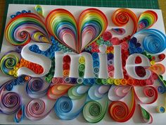 This listing is for a super happy quilling ! Smile is made to order using 5mm acid free quilling papers, colours may vary slightly in places