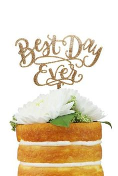 "This golden cake topper states ""Best Day Ever"" in swirling script. It's the perfect way to capture the celebratory sentiment of the day. Features and Facts:  Acrylic  5 3/4""H, 6 1/2""W  Hand wash  USA"