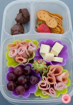 DIY Lunchable, D has ham, cheese, grapes, strawberries, pretzel spoons and some hershey's spread.