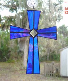 The Cross is made with a iridescent blue glass with wispy milky streaks running through it. It is accented with a very pretty cut glass bevel. The bevel captures the sunlight and will send prisms throughout the room. Stained Glass Suncatchers, Stained Glass Designs, Stained Glass Projects, Stained Glass Patterns, Making Stained Glass, Stained Glass Art, Mosaic Art, Mosaic Glass, Fused Glass