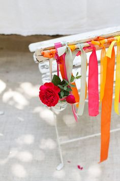 ribbon and flower chair decoration http://weddingwonderland.it/2016/06/idee-matrimonio-colorato.html