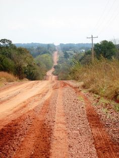 good ole red dirt road, and this is no joke.  When we first moved here I couldn't believe it.  You should have seen the boys white socks turn to a lovely rust color (even with plenty of bleach)