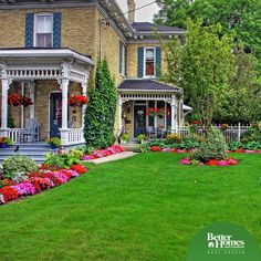 This beautiful landscaping will welcome all your guests into your lovely home.  What a difference flowers and greenery make to a yard.
