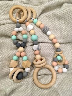 Set of 3 toys made with Wooden and silicone beads for baby play gym/ activity center.  They have large wooden rings of 55mm and 70mm and large beads of 20mm as well as 15mm.  DISCLAIMER: This is not a teething toy, its not safe for babies to put in their mouth, its only to be used as a
