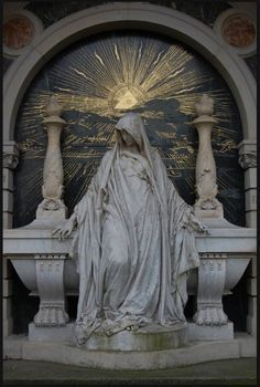 gold and stone Mary