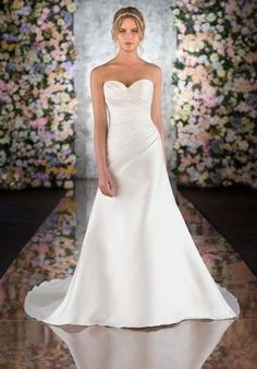 This classic A Line wedding gown comes in your choice of rich Deluxe Dupioni, Silk Taffeta, Silk Zibeline and Duchess Silk Satin and features asymmetrical ruching on the bodice and hip, sweetheart neckline, low V back, and a traditional court train. Lace up or zip up under fabric-covered buttons. This season's designer bridal gowns come in a range of styles, from traditional to beaded Art Deco fit-and-flare to princess-inspired ballgowns. Choosing a minimalist A Line wedding gown such as ...