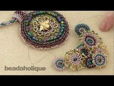 In this tutorial learn how to attach assorted embellishments to a focal piece in bead weaving and bead embroidery. This is a very free form activity and shows you how to literally stitch them in place. Please note that this video is to give you ideas on how to accomplish this task but your project will feature different elements and you will need to adapt this technique to suit your needs.