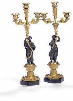 A pair of French Charles X gilt and patinated bronze candela