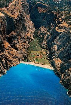 Butterfly Valley, Faralya, Turkey. Beautiful >>> Never been here, will almost certainly never go here, but I love how it looks.