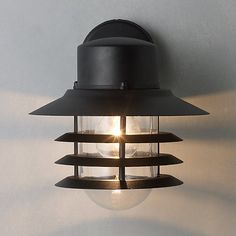 This striking Nordlux Vejers Outdoor Wall Lantern will help create an intimate outdoor space to relax in...