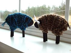Baaaa fiber wrapped sheep with clothespin legs.