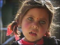 Afghan girl with unusual colored eyes.