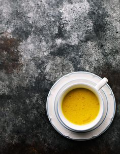 Golden Milk latte with almond milk/cashew milk. This Turmeric tea offers a lot of health benefits. Spiced vegan milk tea with cardamon, ginger, cinnamon, black peppercorn