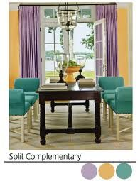 split-complementary color scheme   The color scheme used in this room is called a split-complementary color scheme. Yellow and purple are compliementary colors. By going to the right or left of the purple on the color wheel you either get blue or red. These are Split-complimentary colors. These colors are used in this picture and give the space variety.