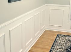 Wainscoting -  wall above the chair rail Mindful Gray by Sherwin Williams.   White below the chair rail.