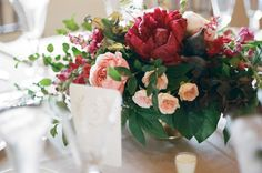 Les Fleurs : garden roses, burgundy peonies and burgundy snap dragons : gold compote : fruit in arrangements : figs, plums and cumquats