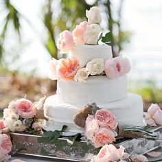 Romantic Roses Wedding Cake | This three-tiered buttercreamed-frosted cake was decorated with ivory and peach garden roses.