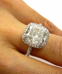 5.07 carat Estate Cushion Diamond Engagement Ring: $19,950.00 (totally worth it though)