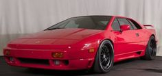 This 1990 Lotus Esprit SE Turbo (VIN: SCCFC20B8LHF65523) is described as a documented, 2-owner, California car with original paint and less than 14k miles. Heavily upgraded, the motor was recently rebuilt and features full ARP fasteners as well as an upgraded turbo and injectors. Wheels are a $6k se