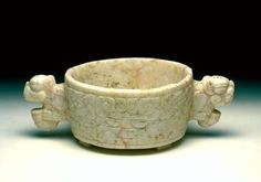 Tripod vessel with two handles  (746)    Tripod vessel with two handles. Central America, Honduras: Ulúa. Late Classic/Early Post-Classic period (AD 800-1000). White marble, with pink veins. h. 7.6 cm. Acquired 1980. Robert and Lisa Sainsbury Collection. UEA 746. www.scva.ac.uk