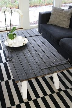 DIY Coffee Table using an old door or shutter. Must reuse the cabin door for sure but there are others.