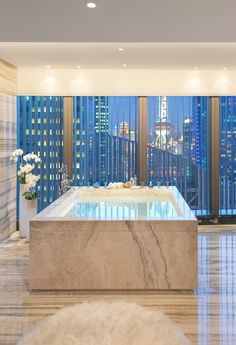 It might take a while to fill, but imagine bathing in this luxury.