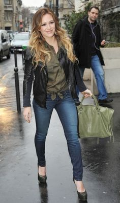 I like that Hilary Duff is color matching her shirt with her purse.