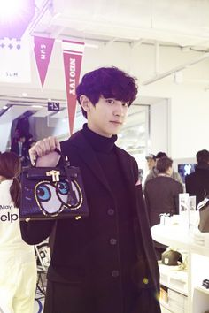 SMTOWN Coexartium pre-opens  Chanyeol modeling that bag well :)