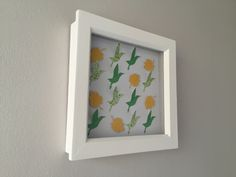 "Frame dimensions - 6""x6"" (15.2cm x 15.2cm)Colours - Birds in mid green and apple green spots with yellow leaves on a white background (PC4, RD5, CL6)Stunning hand crafted leaf and bird framed art. Each leaf in individually embossed with veins to add interest and is raised to create a beautiful 3D effect. Every starling is cut with a blade and then each wing is hand folded. No two starlings are therefore ever exactly the same. Choose this colour scheme or someth..."
