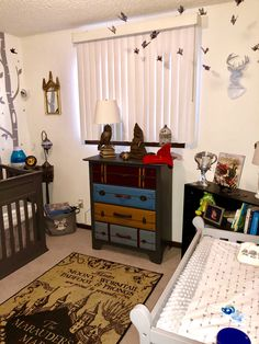 Harry potter nursery theme harry potter nursery in 2019 Baby Harry Potter, Deco Harry Potter, Harry Potter Nursery, Theme Harry Potter, Harry Potter Baby Shower, Nursery Themes, Room Themes, Nursery Ideas, Room Ideas
