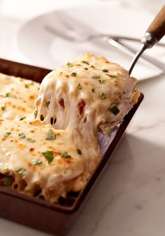 Creamy White Chicken & Artichoke Lasagna – This recipe takes ordinary lasagna to a whole new level. Our instructional video makes it easy to prepare this family-friendly dish—ready for the oven in just 15 minutes flat. If you like cheese, than this is right up your alley—with KRAFT Shredded Mozzarella and Grated Parmesan Cheese.