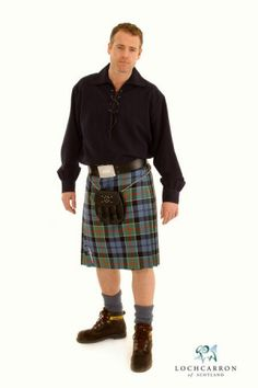 Man with black shirt and blue/green kilt