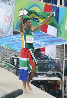 Wayde Van Niekerk of Republic South Africa celebrates his victory and the new…