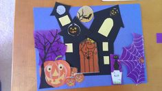 Halloween Craft: Easy Haunted house collage craft made with Halloween theme paper napkins from dollar store and card stock scraps. #Halloweencraft