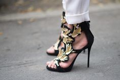 Gold-leaf Giuseppe Zanotti heels that are the focal point of any outfit.